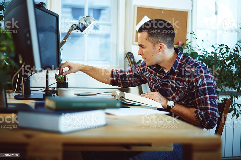 Young man in home office stock photo
