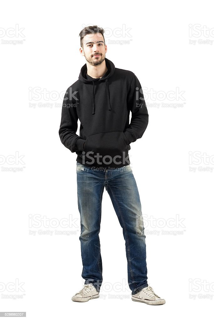 Young man in hoodie with hands in pockets stock photo