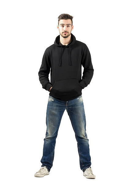 Young man in hoody with hands in pocket stock photo