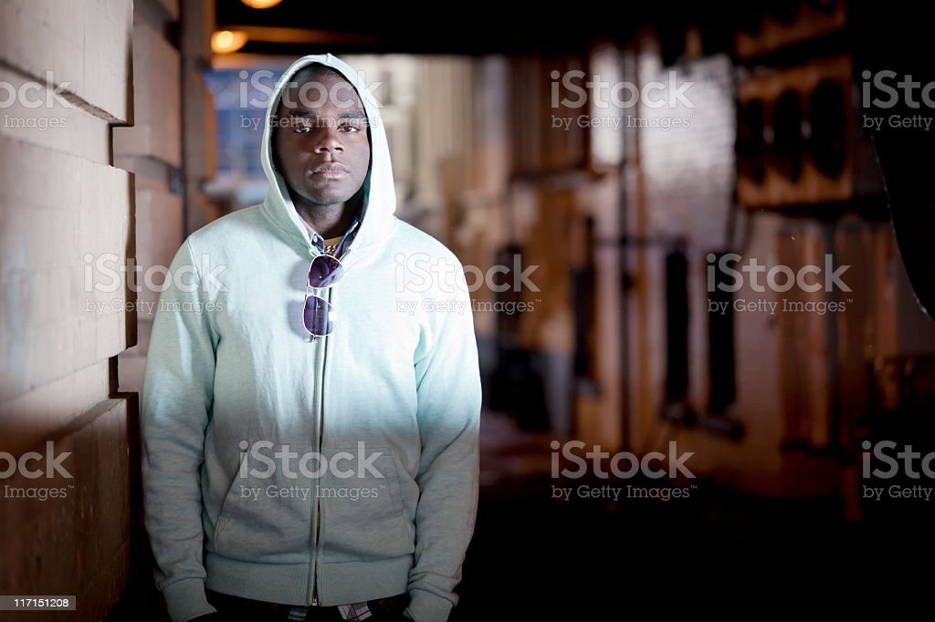 Young man in industrial setting stock photo