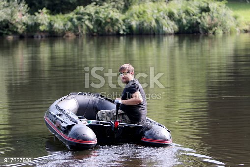 175421347istockphoto Young man in inflatable boat 917227636