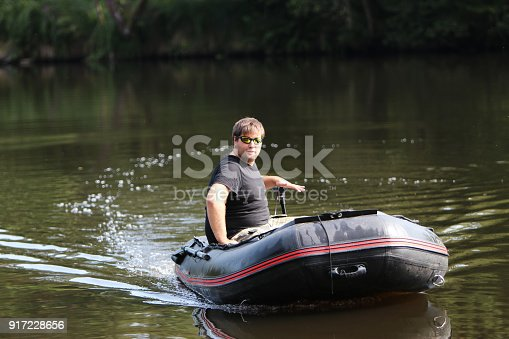 175421347 istock photo Young man in inflatable boat 917228656