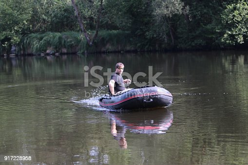 175421347 istock photo Young man in inflatable boat 917228958