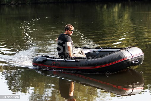 175421347istockphoto Young man in inflatable boat 917229680