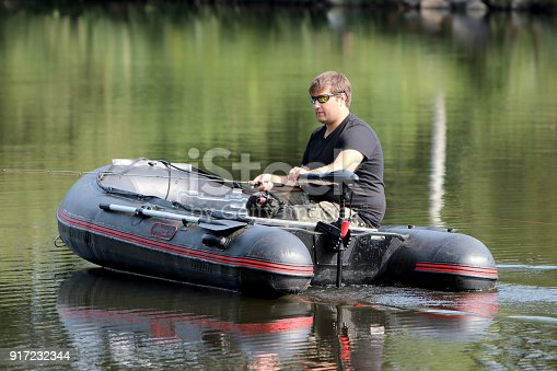 175421347istockphoto Young man in inflatable boat 917232344