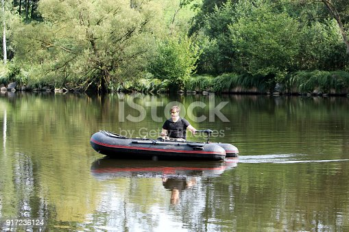 175421347istockphoto Young man in inflatable boat 917236124