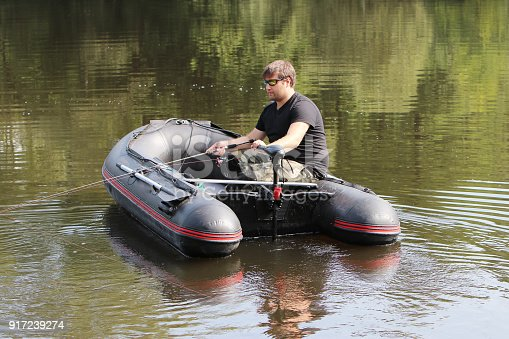 175421347 istock photo Young man in inflatable boat 917239274