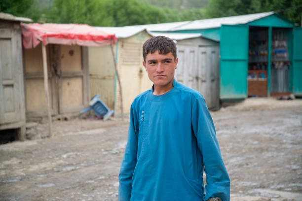 A young man in Ishkashim city center market, Afghanistan. stock photo