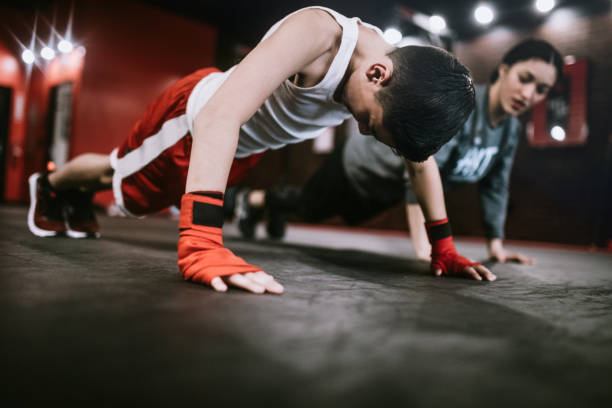 Young Man In Kickboxing Training Center stock photo