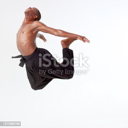 925466128istockphoto Young man in mid air 137088256