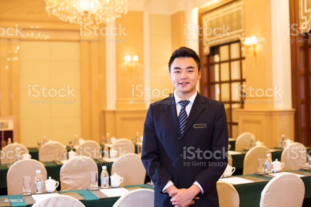 young man in modern dining room stock photo