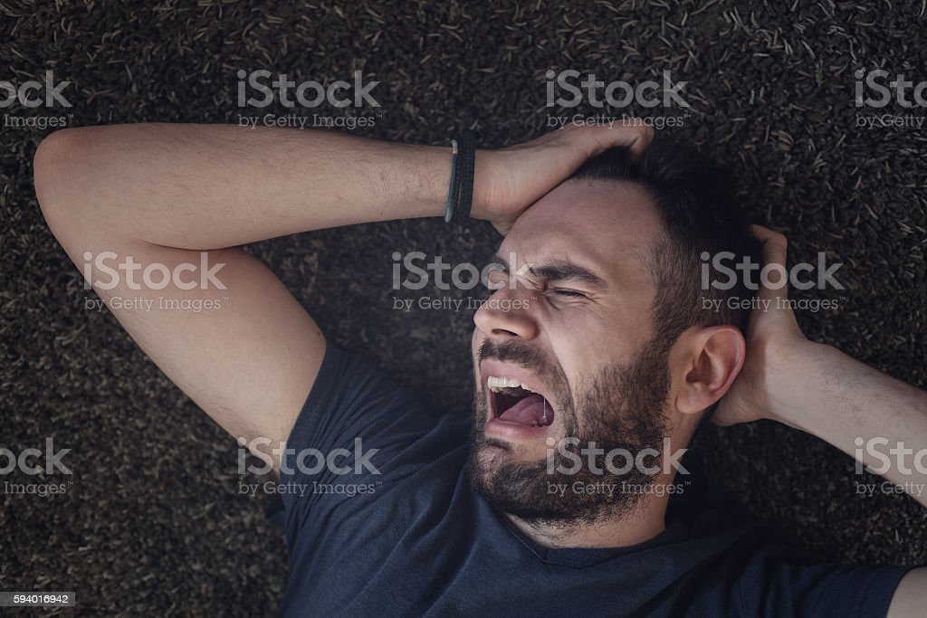 Young man in pain stock photo