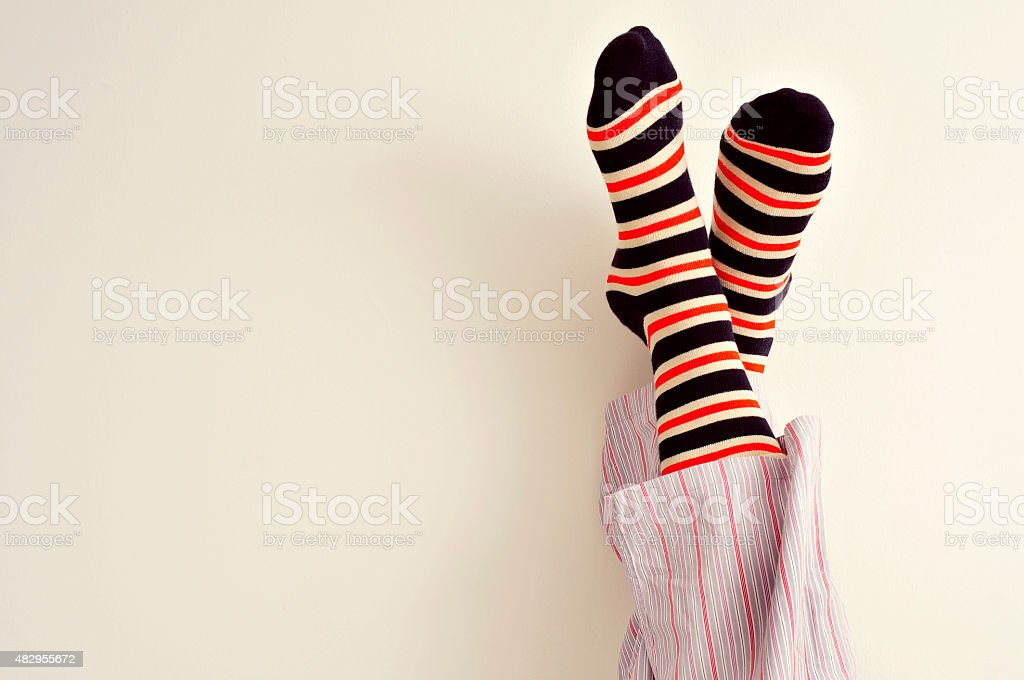 young man in pajamas relaxing stock photo