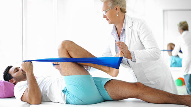 Young man in physical therapy. stock photo