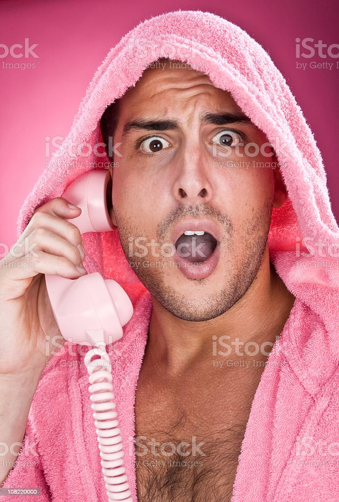 young man in pink expression with phone royalty-free stock photo