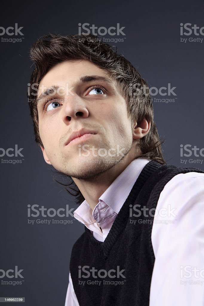 Young man in pink shirt stock photo