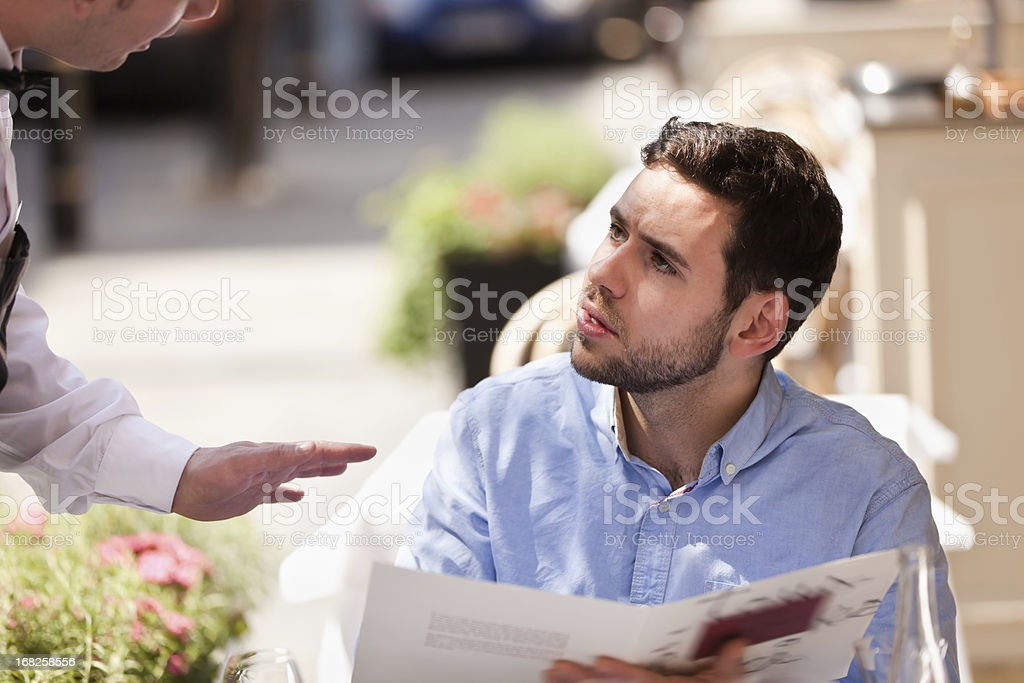 Young Man in Restaurant Cafe stock photo