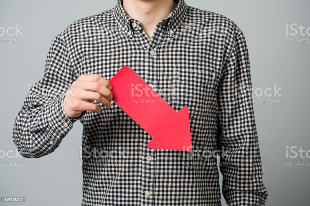 Young man in shirt holding arrows stock photo