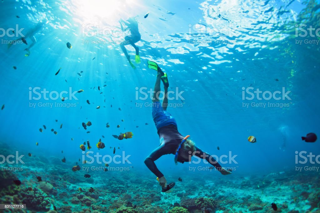 Young man in snorkelling mask dive underwater stock photo