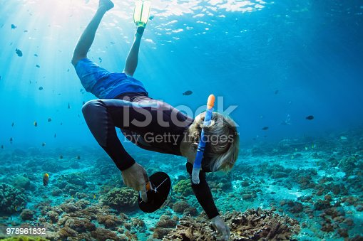 831127716 istock photo Young man in snorkelling mask dive underwater 978961832