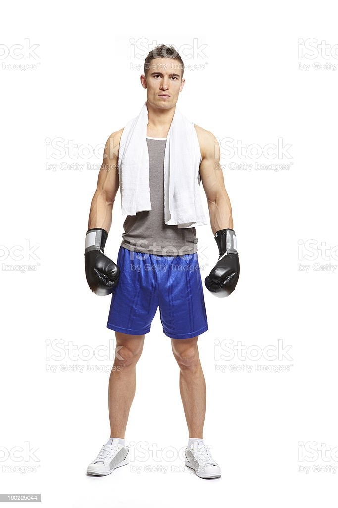 Young man in sports outfit wearing boxing gloves royalty-free stock photo