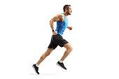istock Young man in sportswear running 1167084433