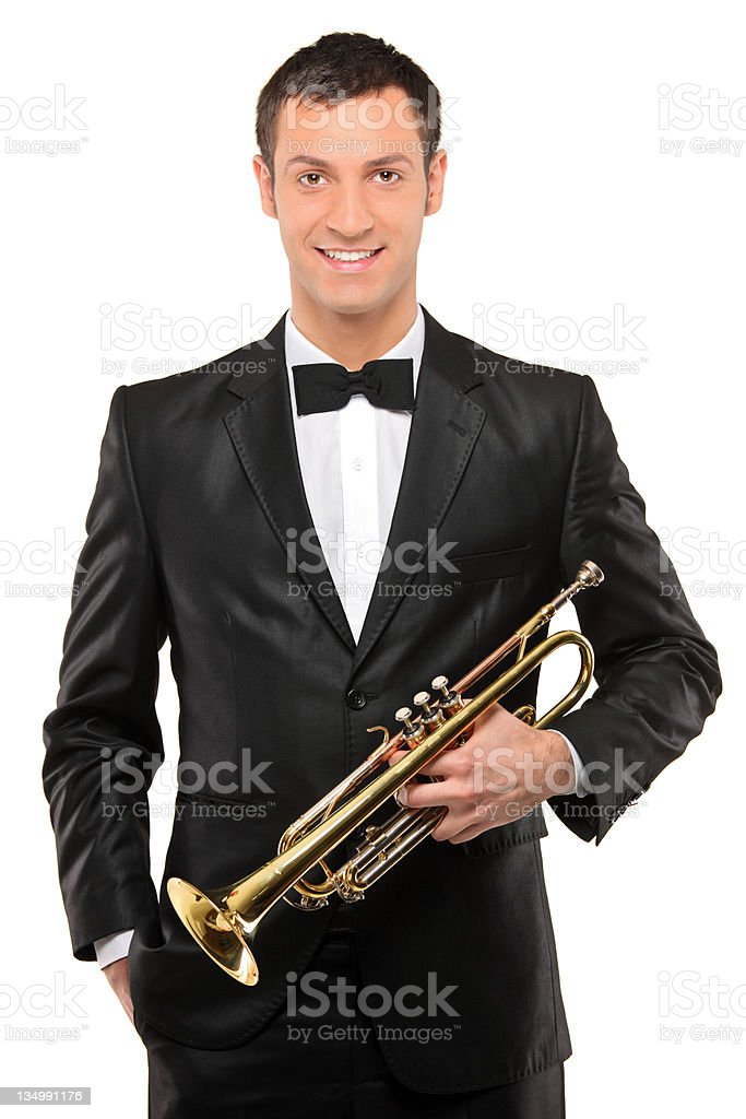Young man in suit holding a trumpet royalty-free stock photo