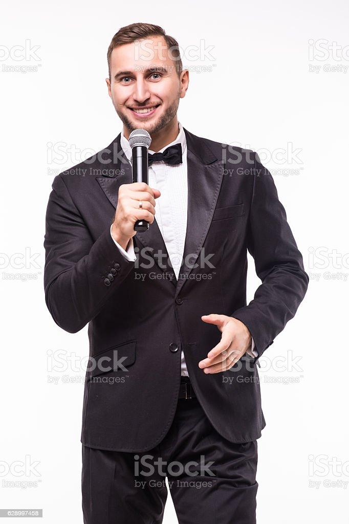 Young man in suit singing over the microphone with energy stock photo