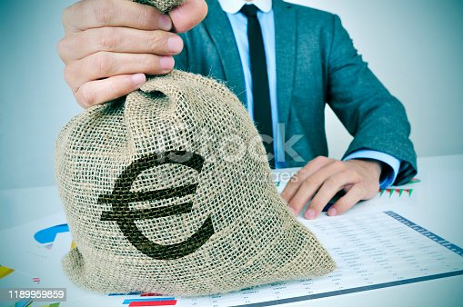 istock young man in suit with a burlap money bag with the euro sign 1189959859