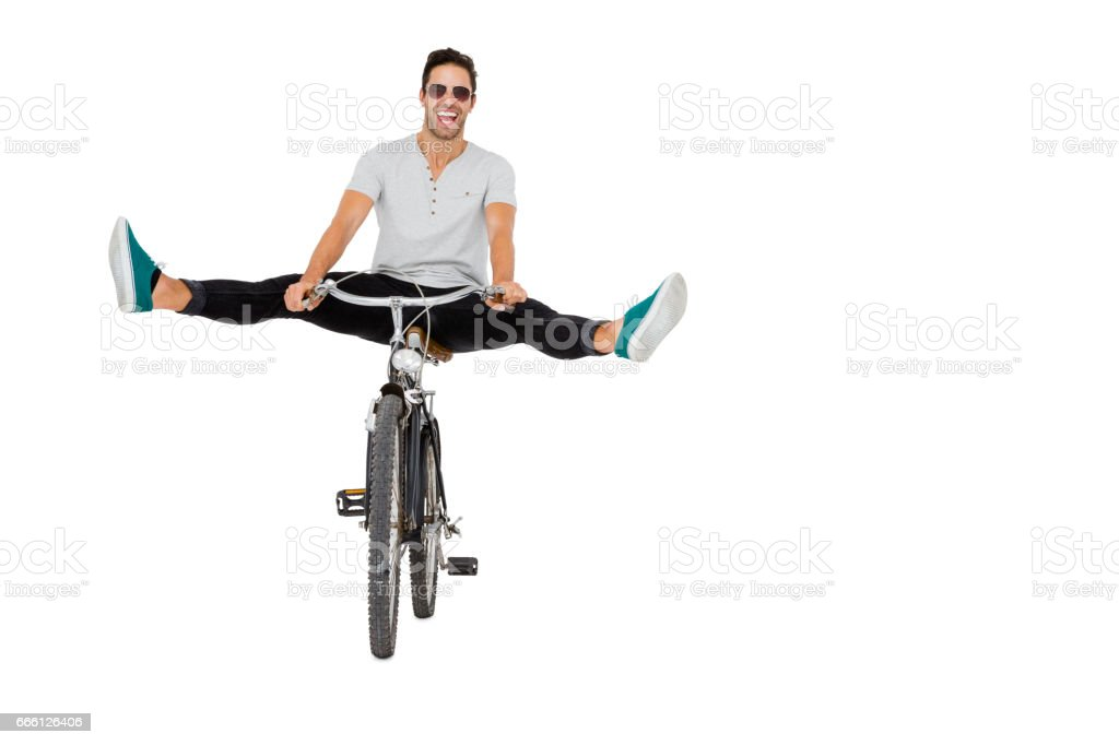 Young man in sunglasses cycling stock photo