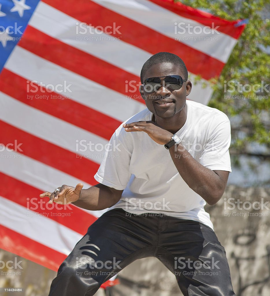 Young man in sunglasses is dancing stock photo