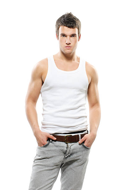 Man tank top pictures images and stock photos istock young man in tank top with hands in pockets stock photo urmus Choice Image