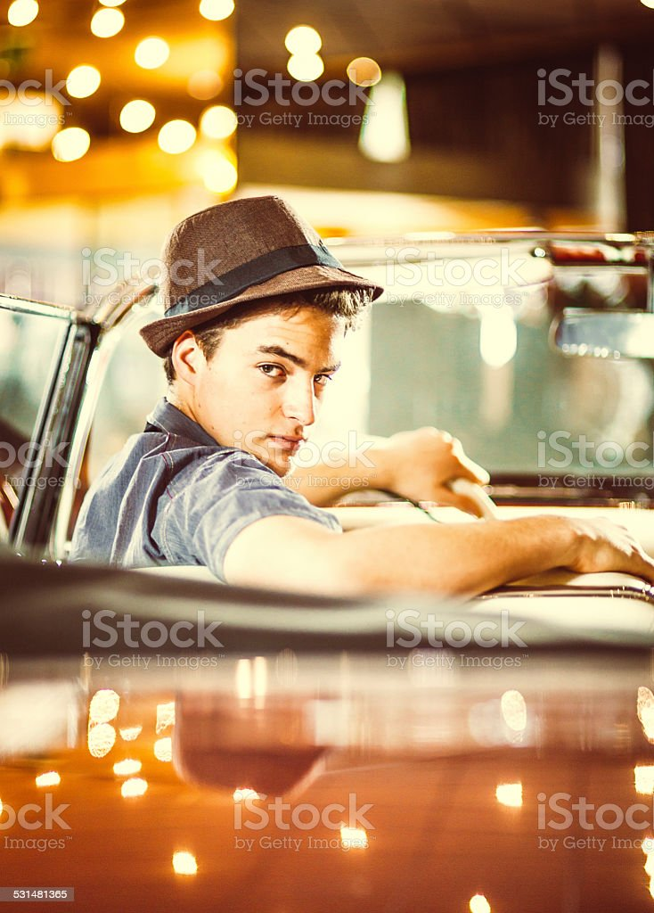 Young man in the car stock photo