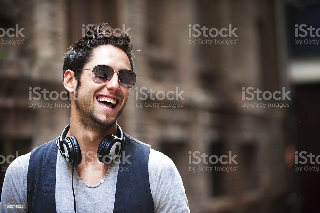 Young man in the city stock photo