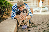 istock Young man in the city with his french bulldog 843173220