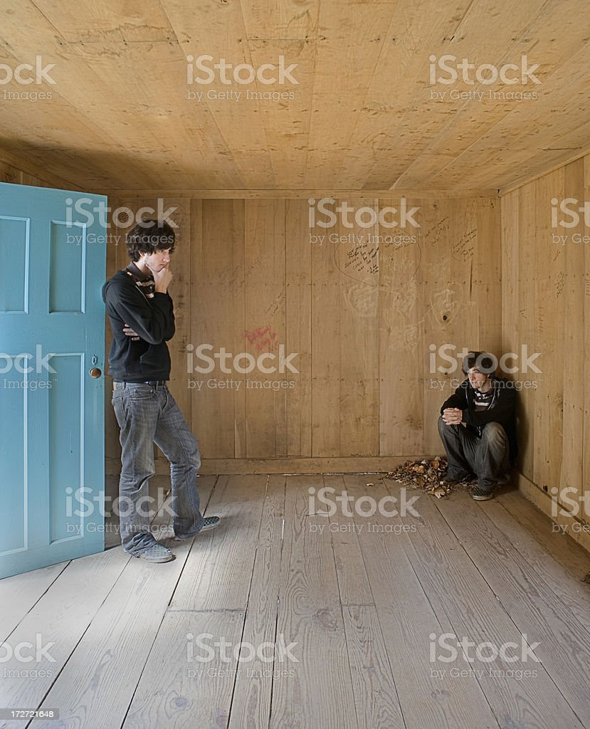 Young man in the corner royalty-free stock photo