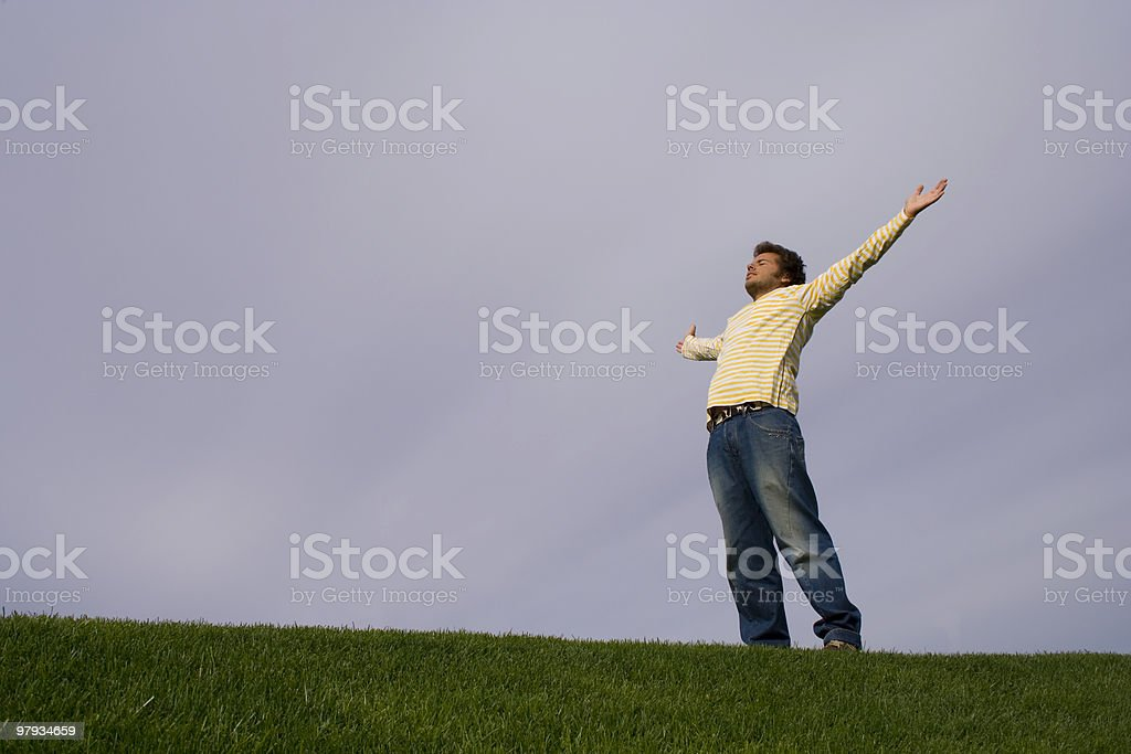 young man in the grass royalty-free stock photo