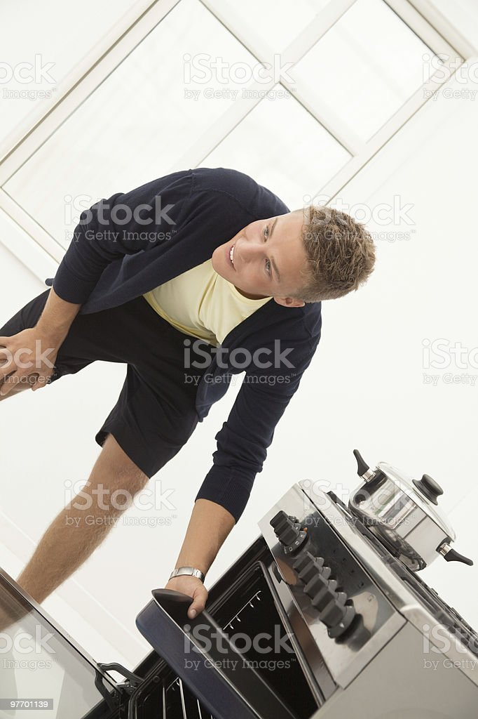 Young man in the kitchen stock photo