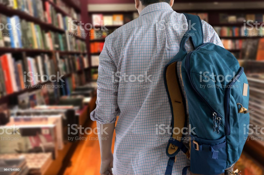 young man In the library books high school library royalty-free stock photo