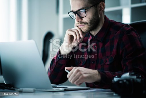 istock Young man in the office 604373752