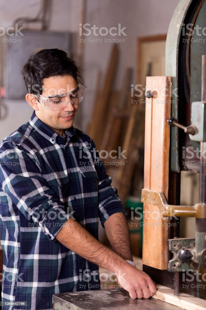 Young Couple manual workers in carpentry workshop