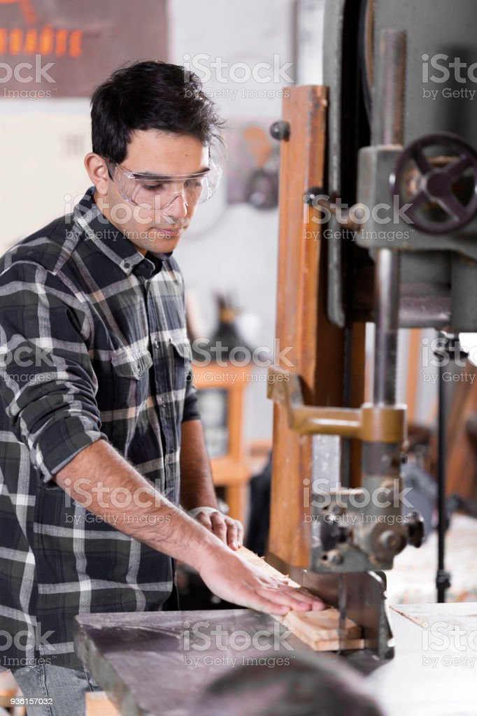 Young man  in their studio - crafts - people stock photo