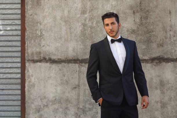 young man in tuxedo - tuxedo stock photos and pictures