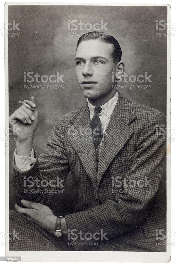 Young Man in Tweed Smoking royalty-free stock photo