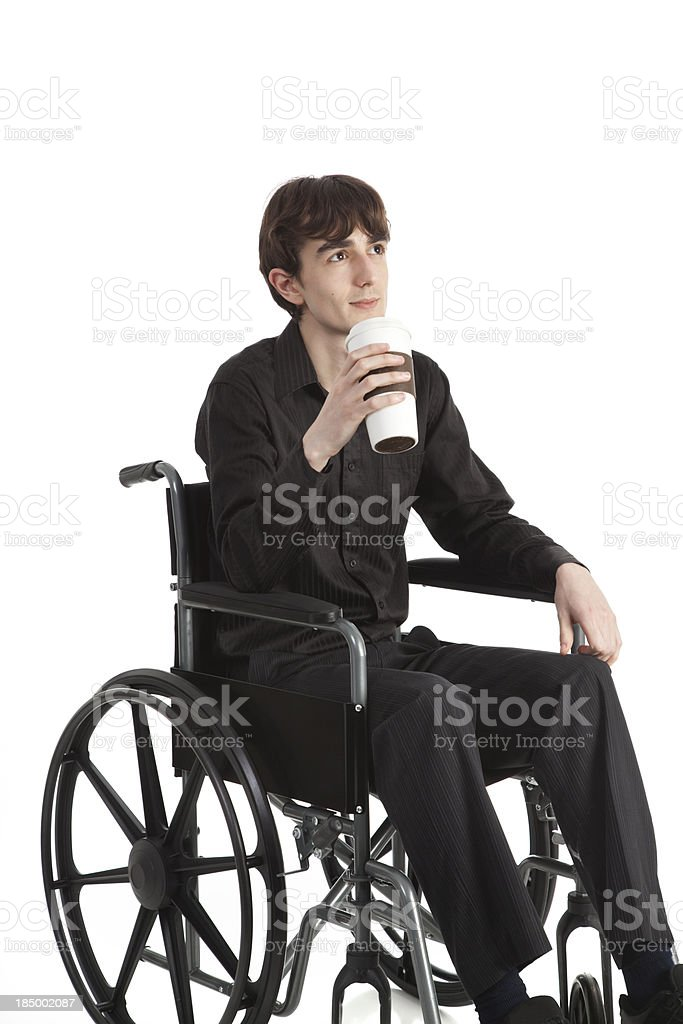 Young Man In Wheelchair With Coffee stock photo