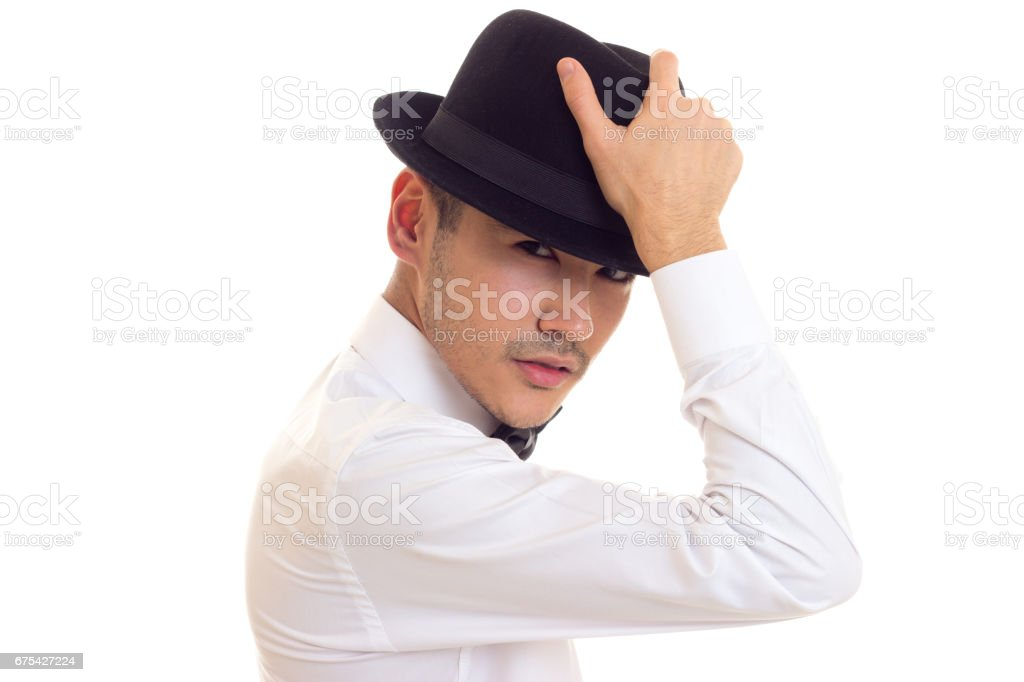 Young man in white T-shirt with black hat photo libre de droits