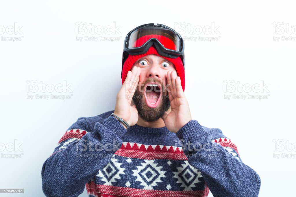Young man in winter outfit shouting Close up of young man in winter outfit shouting on white background Adult Stock Photo