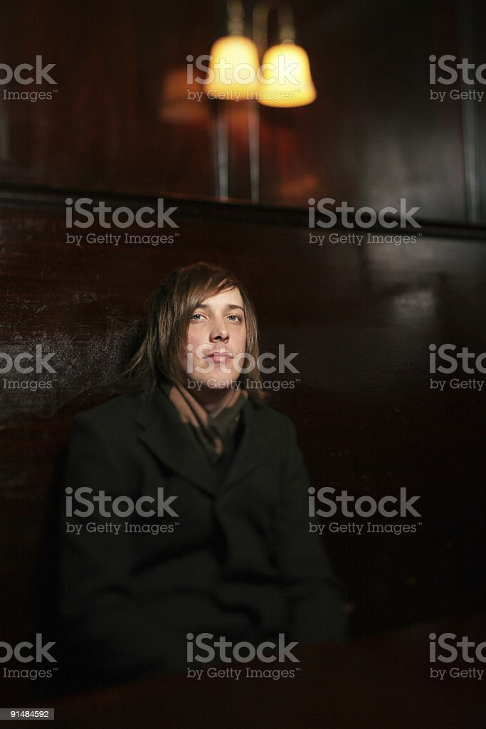 Young Man In Wool Coat At Dark Restaurant Table Stock Photo Download Image Now Istock