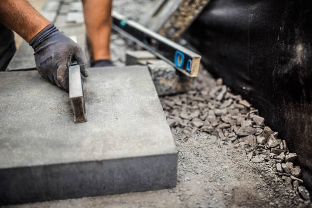 Young man installing paving stones stock photo