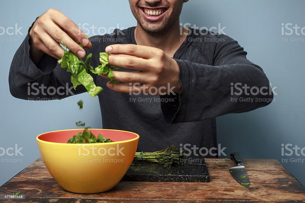 Young man is a happy salad tosser stock photo